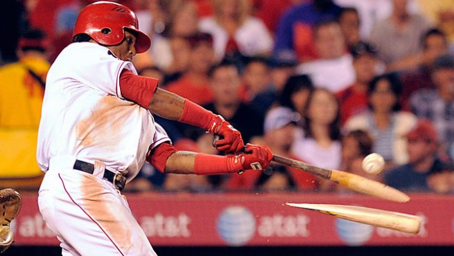 Eric Aybar breaks his bat.