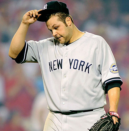 Joba Chamberlain gets taken out of the game after conceding four runs in the fifth inning.